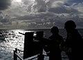 US Navy 041025-N-5384B-005 Aviation Ordnancemen man a .50 caliber machine gun during a general quarters (GQ) drill aboard the Nimitz-class aircraft carrier USS Abraham Lincoln (CVN 72).jpg