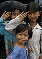US Navy 050119-N-9951E-067 Young girls salute in their best form for a photo taken at one of the camps located in the town of Alue Bilie, Aceh, for civilians displaced by the Dec. 26 tsunami.jpg