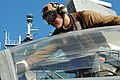 US Navy 050711-N-4321F-063 Aviation Ordnanceman Airman Daniel Best cleans the canopy of an F-A-18F Super Hornet.jpg