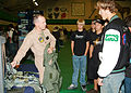 US Navy 051104-N-9845W-016 U.S. Marine Corps Capt. Brendan Powell, assigned to Air Test and Evaluation Squadron Nine (VX-9), explains flight gear that military pilots wear to students from Burroughs High School in Ridgecrest, C.jpg