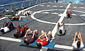 US Navy 060426-N-2736O-001 Sailors stationed aboard the guided-missile frigate USS Underwood (FFG 36) conduct physical training on the flight deck.jpg