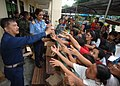 US Navy 060528-N-8391L-240 U.S. Navy Cmdr. Henry Villareal, executive officer of Military Sealift Command (MSC) hospital ship USNS Mercy (T-AH 19), gives away free hygienic products to residents of Zamboanga at the local Recodo.jpg