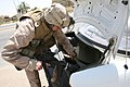 US Navy 060620-M-0008D-024 U.S. Navy Hospital Corpsman 3rd Class William T. Corso searches inside a vehicle for insurgent propaganda during a snap vehicle checkpoint patrol in the city of Ramadi.jpg