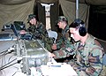 US Navy 060831-N-3560G-004 Members of Naval Mobile Construction Battalion Four (NMCB-4) handle communications traffic.jpg