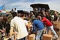 US Navy 070120-M-3815P-061 U.S. Marines, Philippine army soldiers and local residents work together to unload and distribute a pallet of donated items during Operation Goodwill Delivery II.jpg