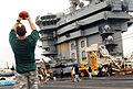 US Navy 070725-N-9760Z-136 Sailors and Marines play football during a steel beach picnic on the flight deck of nuclear-powered aircraft carrier USS Nimitz (CVN 68).jpg