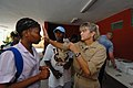 US Navy 070905-N-8704K-061 U.S. Navy Cmdr. Anna Stalcup, attached to Military Sealift Command hospital ship USNS Comfort (T-AH 20), performs optometry tests for a patient with the help of a Creole translator at Hôpital Universitaire.jpg