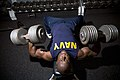 US Navy 071017-N-0995C-008 Chief Mineman Kevin Sperling, an officer recruiter at Navy Recruiting Processing Station Honolulu, presses two 105-pound dumbbells.jpg