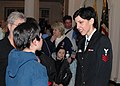 US Navy 071116-N-0773H-132 Musician 1st Class Amanda Polychronis talks to a young patron after the concert by the.jpg