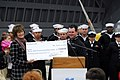 US Navy 080123-N-9150R-033 Professional golfer, Rory Sabbatini, presents a check for $170,000 to the United Through Reading (UTR) program while visiting amphibious assault ship USS Boxer (LHD 4).jpg