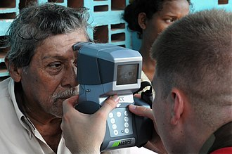 Autorefractor - A United States Navy optometrist technician using an autorefractor during a humanitarian assistance project in Nicaragua in 2008