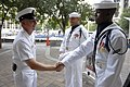 US Navy 080812-N-9818V-081 Fleet Master Chief Rick West, U.S. Fleet Forces Command, left, meets Airman Apprentice Mervin Laravasquez, center, and Culinary Specialist Seaman Apprentice Drayvon Hughes, both assigned to the U.S. N.jpg