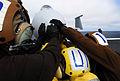 US Navy 080928-N-2610F-089 Flight deck personnel push back an F-A-18C Hornet.jpg