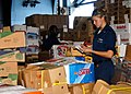 US Navy 081002-N-2074H-072 Information Systems Technician 3rd Class Isabella Concepcion inventories crates of fruit and vegetables.jpg