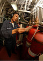 US Navy 090726-N-5148B-080 Damage Controlman 1st Class April Williams, from Oklahoma City, Okla., verifies tags on halon bottles in Main Machinery Room 2 aboard the amphibious dock landing ship USS Rushmore (LSD 47).jpg