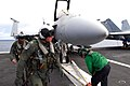 US Navy 090801-N-9760Z-018 Rear Adm. John W. Miller, commander of Carrier Strike Group Eleven (CVW) 11, performs a pre-flight inspection of an F-A-18F Super Hornet assigned to the Black Aces of Strike Fighter Squadron (VFA) 41.jpg