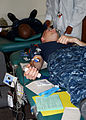 US Navy 100527-N-7642M-017 Aviation Boatswain's Mate (Handling) Seaman Mark Alexander, assigned to USS Constitution, donates blood to the American Red Cross as part of the Red Sox Blood Donor of the Game.jpg