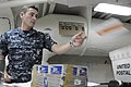 US Navy 100709-N-2918M-049 Logistics Specialist Seaman Noel Gallager sorts mail in the post office aboard USS Nimitz (CVN 68).jpg