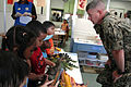 US Navy 100830-N-9818V-333 Master Chief Petty Officer of the Navy (MCPON) Rick West talks with children at the Child Development Center during his visit to Fleet Activities Yokosuka.jpg