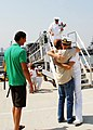 US Navy 110608-N-YT478-054 Lt. Nick Townsend hugs his father as his brother looks on after returning to Naval Station Norfolk following a seven-mon.jpg