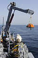 US Navy 110721-N-WL435-082 A simulated mine shape is recovered and craned aboard USS Gladiator (MCM 11).jpg