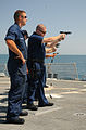 US Navy 111014-N-XQ375-088 Sailors aboard the guided-missile destroyer USS Mitscher (DDG 57) fire 9mm pistols during a small arms qualification cou.jpg