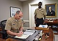 US Navy 111031-N-FC670-004 Chief of Naval Operations (CNO) Adm. Jonathan Greenert reads the Combined Federal Campaign (CFC) pamphlet.jpg