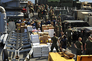 US Navy 111210-N-KS651-381 Sailors and Marines aboard USS Pearl Harbor move supplies during a replenishment at sea.jpg