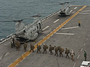 US Navy 111214-N-DX615-090 Marines embark a CH-46E Sea Stallion helicopter.jpg