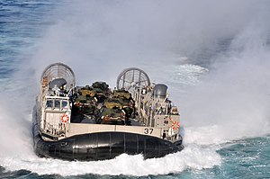 US Navy 120202-N-UM734-806 A landing craft air cushion approaches the welldeck of the amphibious assault ship USS Kearsarge (LHD 3) during Bold All.jpg
