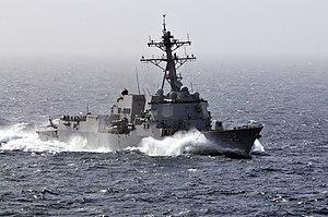 US Navy 120213-N-ZI635-406 The Arleigh Burke-class guided-missile destroyer USS Momsen (DDG 92) pulls alongside the Nimitz-class aircraft carrier U.jpg