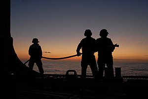 US Navy 120214-N-ZZ999-001 Sailors man the number one hose team aboard the guided-missile frigate USS Ingraham (FFG 61) during a simulated emergenc.jpg