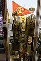 """Uniforms, items, etc. of Norwegian Labour Service (""""kvinnebefal-fylkesleder i NS Arbeidestjenesten, AT""""); songbook; pennants; propaganda posters; flag pole top; German skis; etc. Lofoten Krigsminnemuseum 2019-05-08 DSC00116.jpg"""