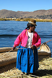 A Uro woman on a floating islet on Lake Titicaca.