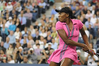 2009 US Open (tennis) - Venus Williams returns against Vera Dushevina on the opening day