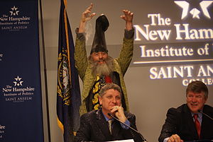 Vermin Supreme - Supreme glitter bombs Randall Terry during a forum at the New Hampshire Institute of Politics at Saint Anselm College in December 2011.