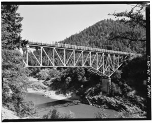 View to northeast. Oblique view of upstream side of bridge. (90mm lens) - South Fork Trinity River Bridge, State Highway 299 spanning South Fork Trinity River, Salyer, Trinity HAER CAL,53-SALY.V,1-1.tif