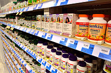 Rows and rows of pill bottles on shelves