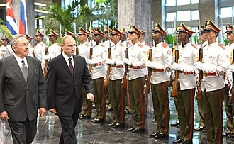 Cuban Revolutionary Armed Forces - Vladimir Putin inspecting the Army Guard of Honour at the Palace of the Revolution in Havana in 2014.