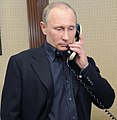 Vladimir Putin talks on a phone (cropped1).jpeg