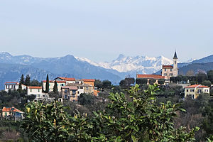 Colomars - A view of the church of Colomars, from the road to Nice