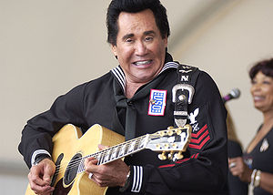 Wayne Newton - Wayne Newton strums the guitar during his USO show at the Patriotic Festival held on the Virginia Beach Oceanfront. May, 2005.