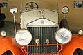 White and orange Rolls Royce closeup.jpg