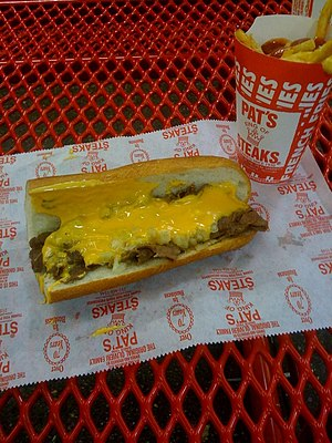 A cheesesteak sandwich from Pat's with Cheez W...
