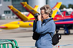 Woman with camera at jersey airport.JPG