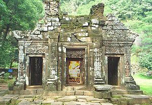 Vat Phou - The facade of the sanctuary. The Buddha image inside is modern - the site is still used for religious worship today.