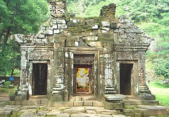 Vat Phou - The facade of the sanctuary. The Buddha image inside is modern, and the site is used for religious worship today.
