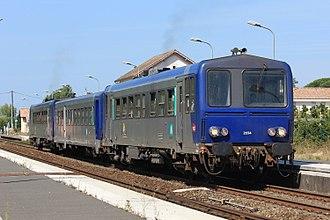 SNCF Class X 2200 - X 2234, an XR 6000 and another X 2200 at the Saint-André-de-Cubzac station with TER 865122 (Bordeaux-Saint-Jean – Saint-Mariens – Saint-Yzan) train.