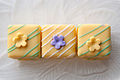 Yellow Easter petits fours with flowers and stripes.jpg
