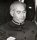A black and white photo of Wajahat Haider, during a meeting
